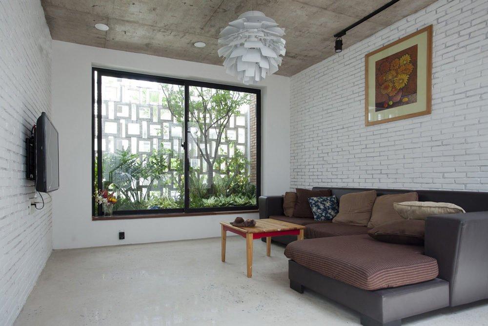ngoi nha o sai gon 11 Ngôi nhà giữa nhà ở Sài Gòn thoáng đãng với vườn cây qpdesign