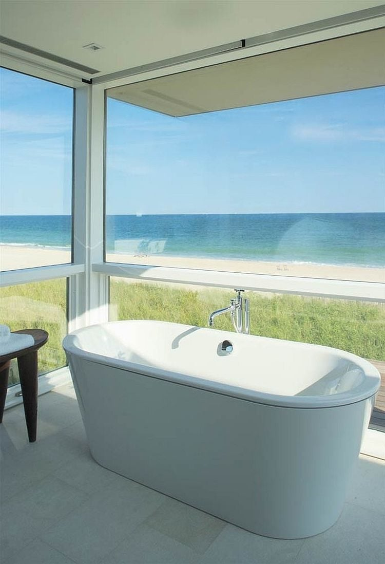 8Revamped-beach-front-home-with-a-bathroom-that-opens-towards-the-view-outside