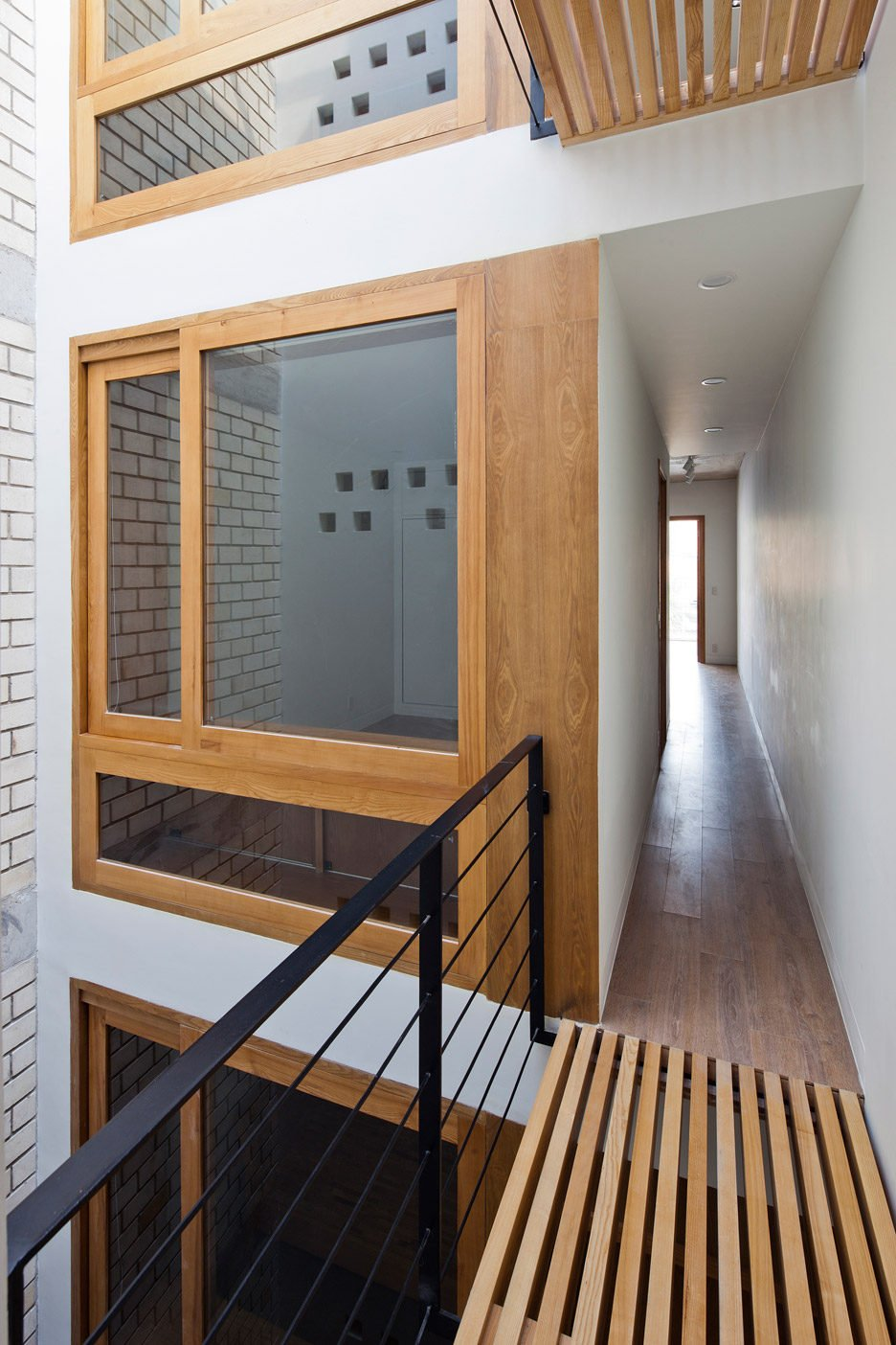 Townhouse-with-a-folding-up-shutter_Vietnam_MM-Architects_dezeen_936_14