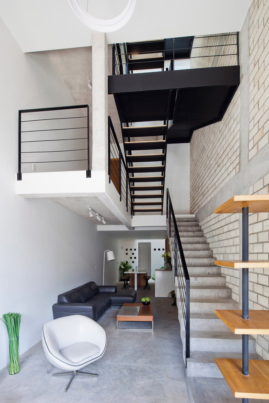 Townhouse-with-a-folding-up-shutter_Vietnam_MM-Architects_dezeen_936_4