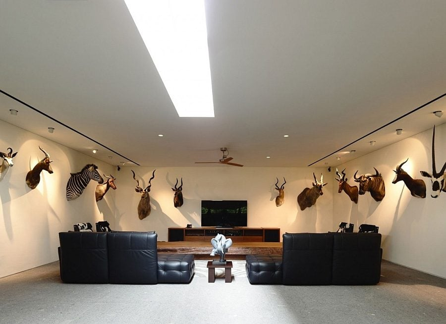 Hard-to-miss-the-wall-additions-in-this-interesting-entertainment-room