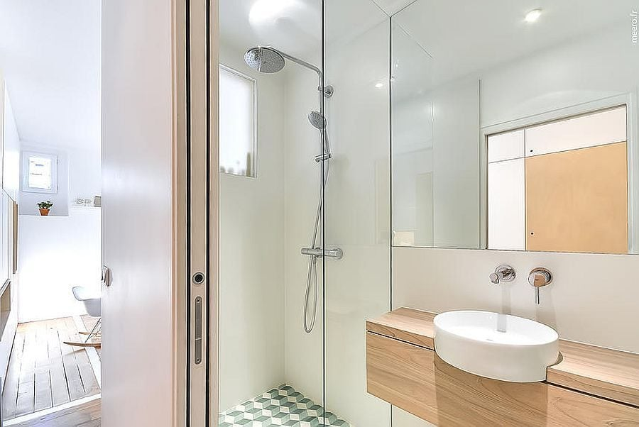 Small-bathroom-inside-the-apartment-with-glass-shower-area