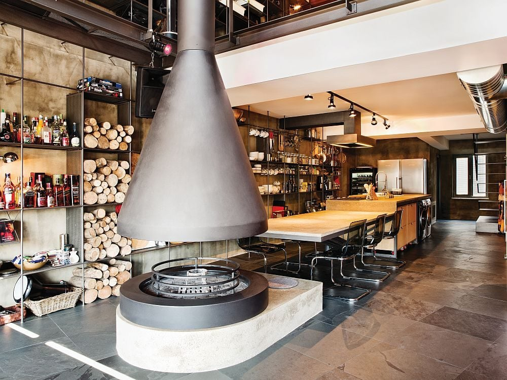 Innovative-fireplace-design-next-to-the-kitchen-and-dining-area