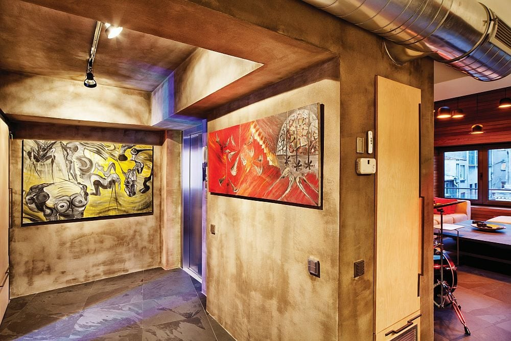 Interesting-wall-art-adds-color-to-the-wooden-walls