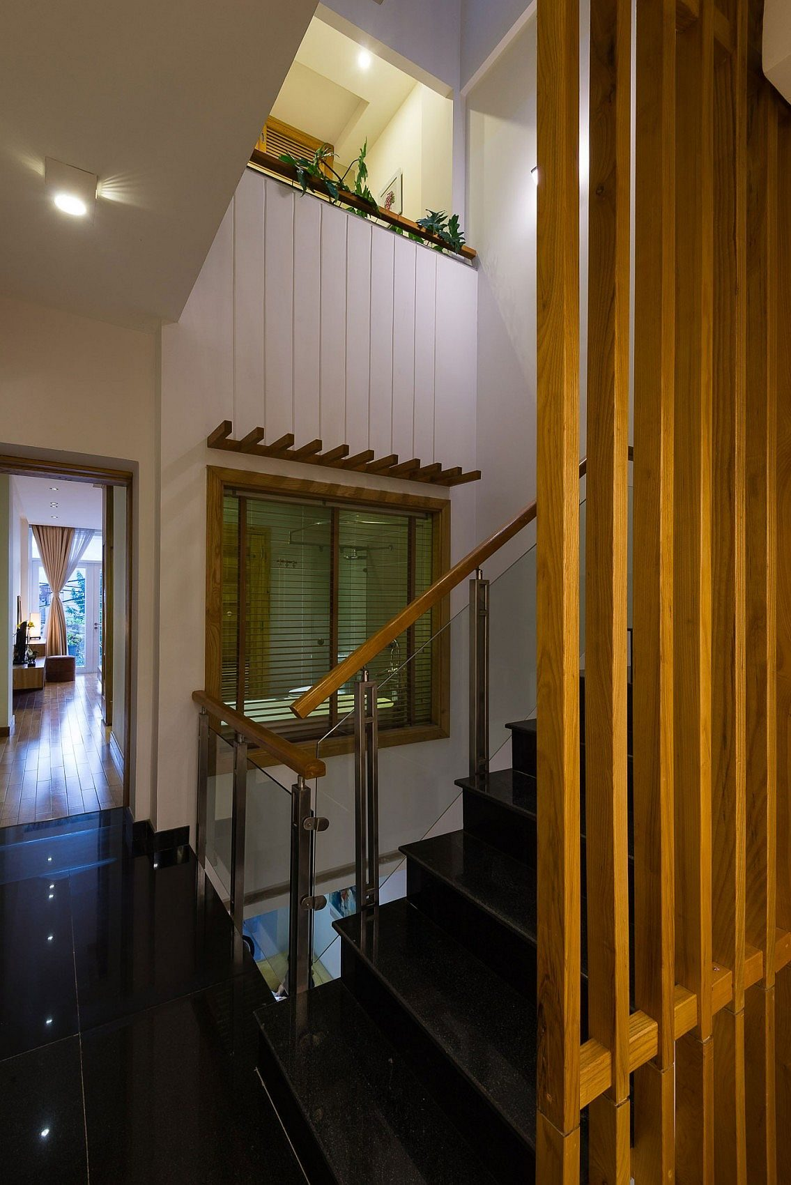 Light-well-next-to-the-brings-illuminates-the-various-levels-of-the-narrow-home