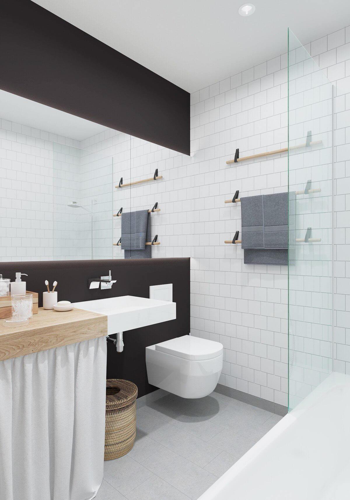 bathroom white subway tile black paint Hô biến căn hộ dưới 50m2 thành không gian rộng rãi và cá tính qpdesign