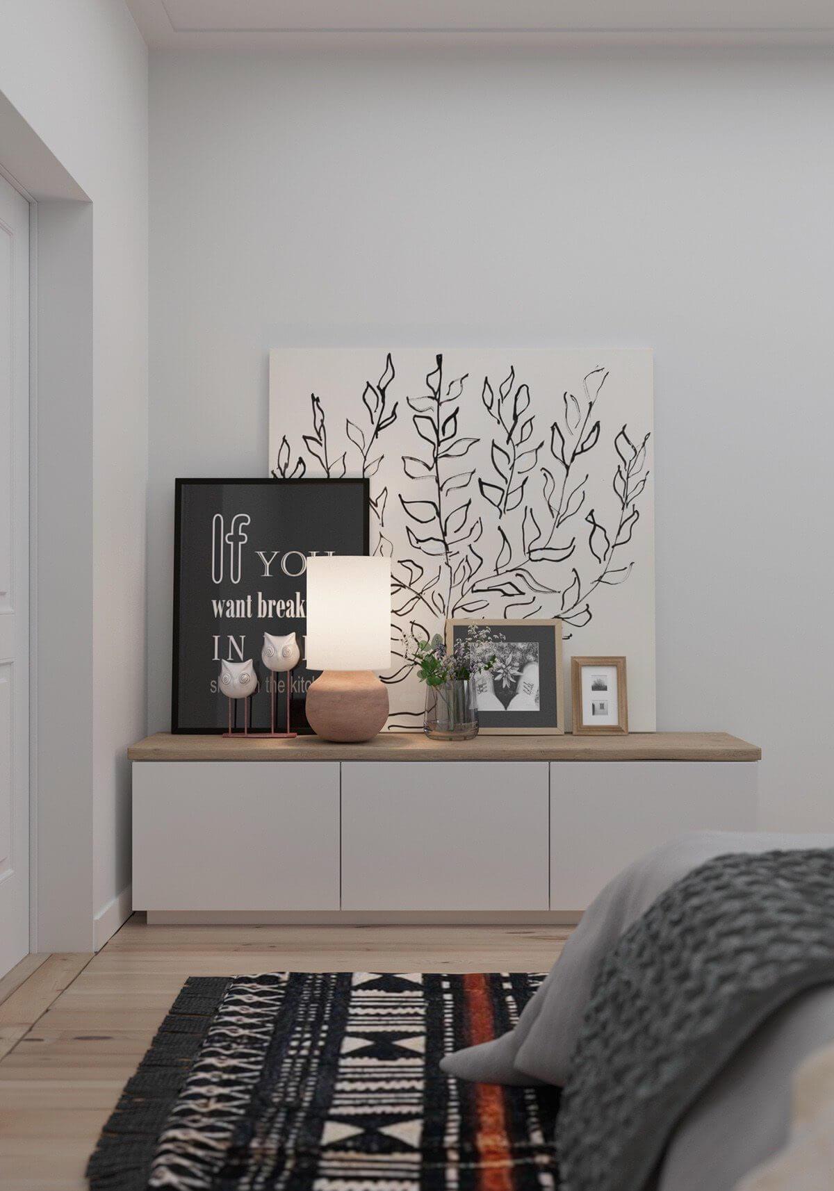 bedroom white shelf pictures art  Hô biến căn hộ dưới 50m2 thành không gian rộng rãi và cá tính qpdesign