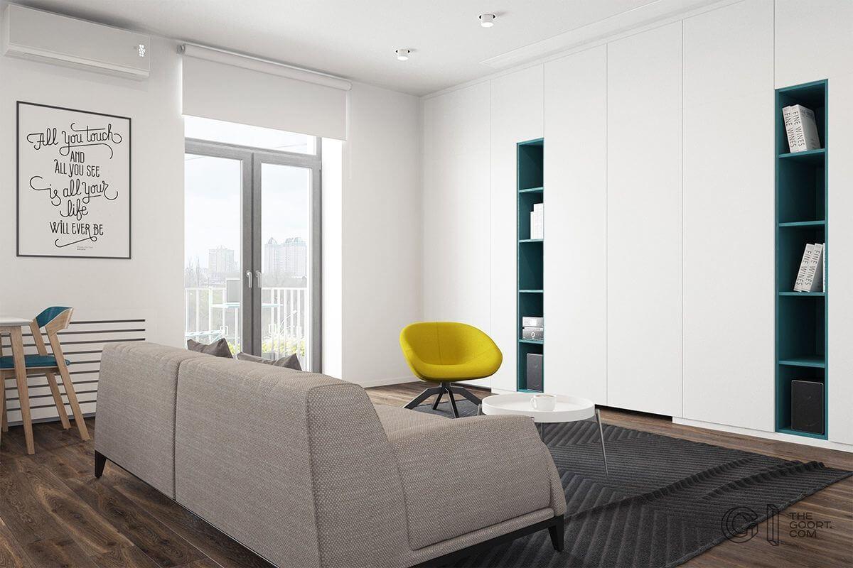 living room teal bookshelves yellow chair Hô biến căn hộ dưới 50m2 thành không gian rộng rãi và cá tính qpdesign